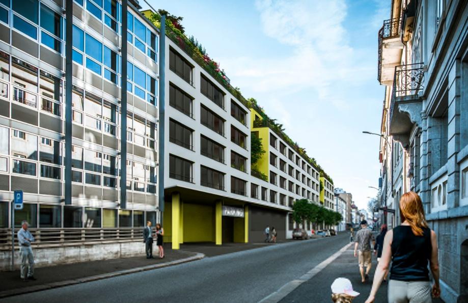 Dans le cadre du projet ILOT, Implenia construit un bâtiment à usage mixte dans le centre de La Chaux-de-Fonds. En dehors des bureaux et surfaces commerciales, des logements en propriété ou locatifs, ainsi qu'un parking public souterrain seront également aménagés. (Photo: Dubois SA, La Chaux-de-Fonds)